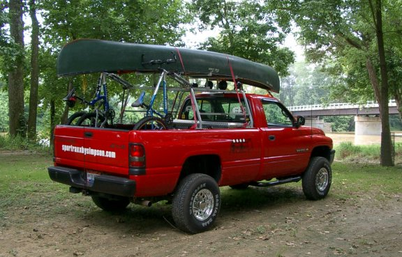 2 canoes on a truck